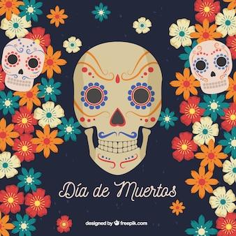 Tło dni zmarłych z kwiatami i czaszkami