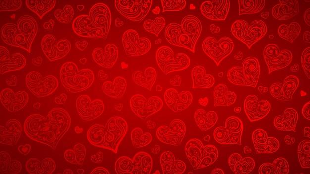 Tło dużych i małych serc z ornamentem z loków, kwiatów i liści, w kolorach czerwonym