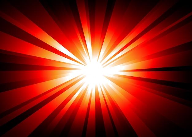Tło eksplozji światła z pomarańczowymi i czerwonymi światłami.