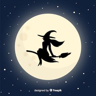 Tło księżyc i czarownica