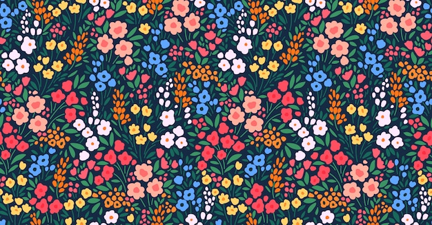 Tło kwiatowy. kwiatowy wzór z małymi kolorowymi kwiatami na ciemnym niebieskim tle