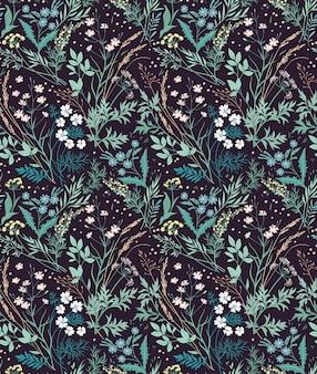 Tło kwiatowy. wzór z małych kwiatów na czarnym tle.