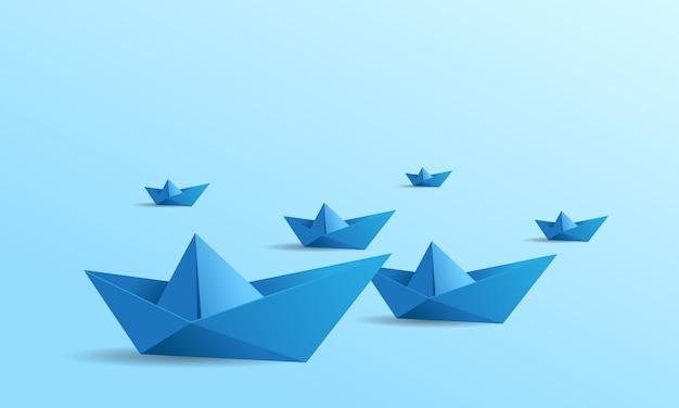 Tło łódź papieru z kolorem niebieskim