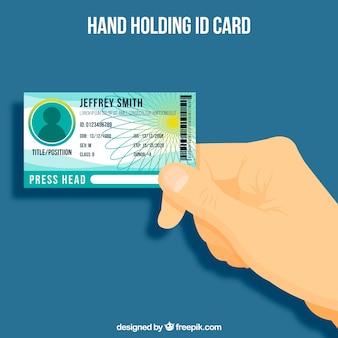 Tło ręki mienia id karta