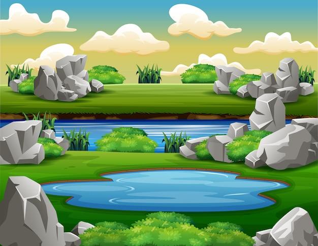 Tło scena z skałami wokoło stawu