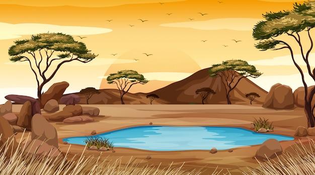Tło scena z stawem w pustynnej ziemi