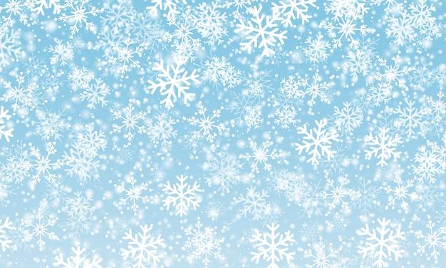 Tło śniegu. niebieskie niebo. spadający śnieg.