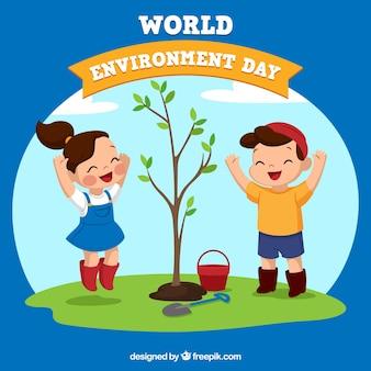 Tło szczęśliwych dzieci sadzenia drzewa