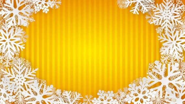Tło w paski w żółtych kolorach z białymi płatkami śniegu