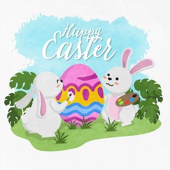 Tło w stylu przypominającym akwarele słodkie króliki malowanie dekoracji paschalne jajo wesołych świąt