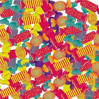 Tło wielu kolorowych cukierków w wielu kształtach