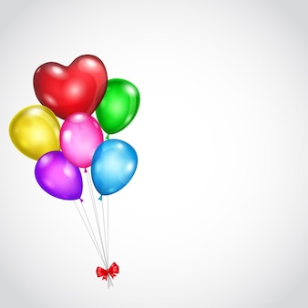 Tło z bukietem kolorowych balonów i czerwoną kokardką