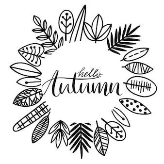 Tło z czarno-białych liści jesienią z ręcznie rysowanym napisem. ilustracja wieniec.