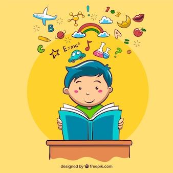 Tło z przedmiotów dekoracyjnych i chłopiec czytania
