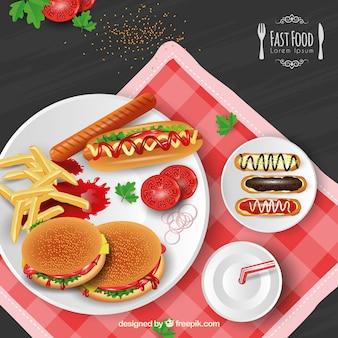 Tło z pysznym fast foodów w realistycznym stylu