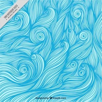 Tło z ręcznie rysowane niebieskie fale