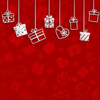 Tło z wiszącymi pudełkami prezentowymi, białe na czerwonym
