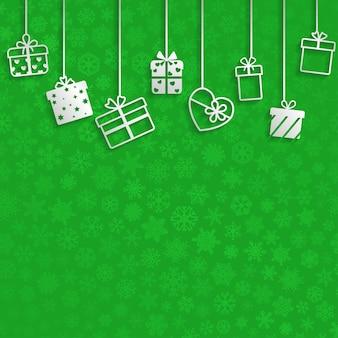 Tło z wiszącymi pudełkami prezentowymi, białe na zielonym