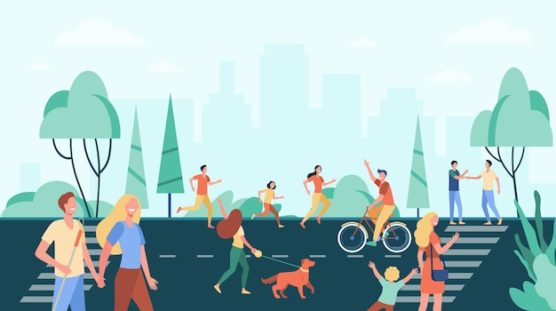 Tłum ludzi ćwiczących i spędzających wolny czas na ulicy w pobliżu parku miejskiego.