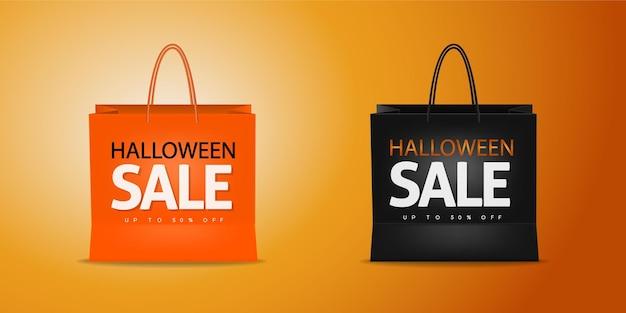 Torba na zakupy prezent z napisem halloween sale na białym tle na pomarańczowym tle promocja rabatowa