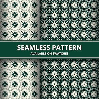 Tradycyjna batikowa bezszwowa deseniowa tło klasyka tapeta. elegancki geometryczny kształt. luksusowe etniczne tło w kolorze zielonym