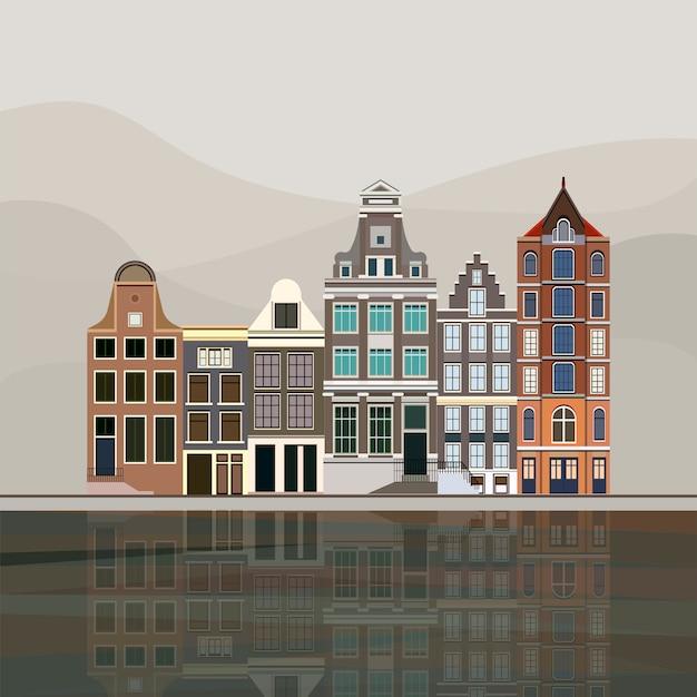 Tradycyjne europejskie domy kanałowe w amsterdamie