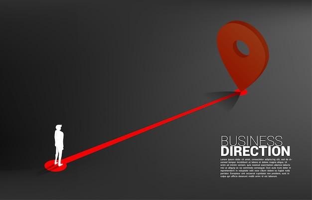 Trasa między znacznikami lokalizacji 3d a biznesmenem. koncepcja lokalizacji i kierunku działalności.