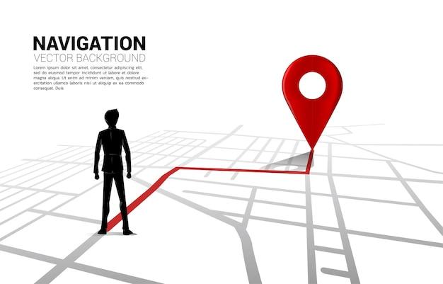 Trasa między znacznikami pinezek lokalizacji 3d a biznesmenem na mapie drogowej miasta.