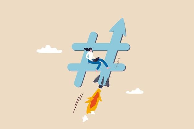 Trend online, popularne hashtagi lub rozmowy w mediach społecznościowych, koncepcja marketingu cyfrowego lub strategii reklamowej, młoda kobieta marketer korzystająca z laptopa na ruchomym hashtagu z rakietowym wzmacniaczem.