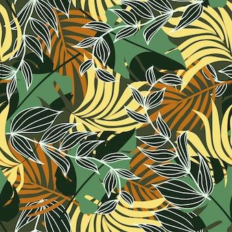 Trendu bezszwowy wzór z kolorowymi tropikalnymi liśćmi i roślinami