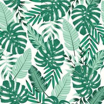 Trendu bezszwowy wzór z tropikalnymi liśćmi na ciemnym tle