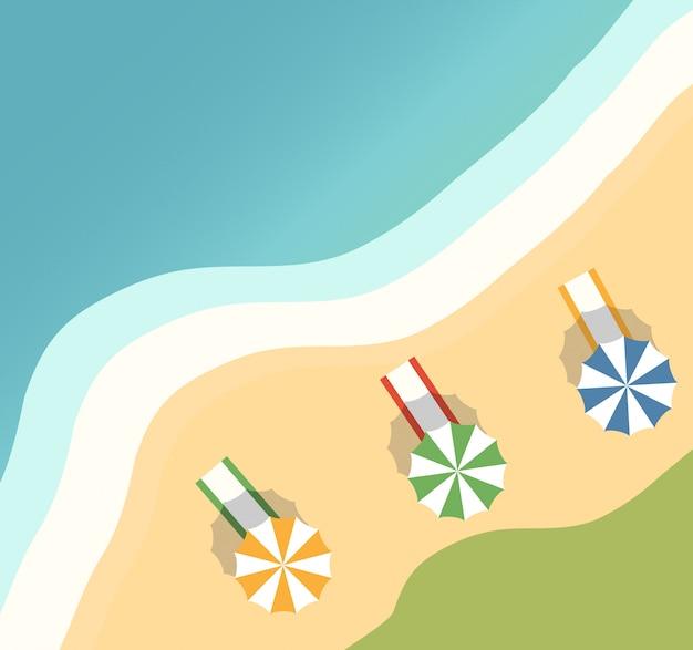 Tropikalna wyspa z palmami i piaszczystą plażą. ręczniki plażowe i parasol przeciwsłoneczny. letnie wakacje w miejscowości.