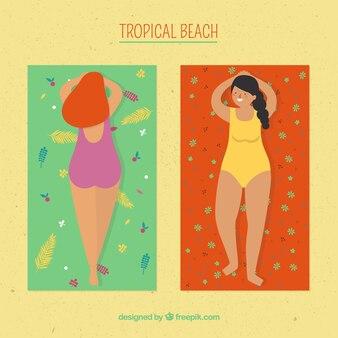 Tropikalny plażowy tło z ludźmi sunbathing