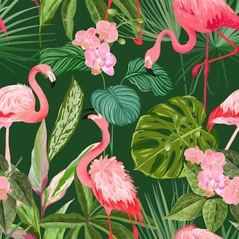 Tropikalny tło z flamingiem, liśćmi palmowymi i kwiatami orchidei. bezszwowy kwiatowy nadruk z egzotycznymi kwiatami i wzorem zielonej dżungli, tropikalna ozdoba do nadruku na tkaninie lub odzieży. ilustracja wektorowa