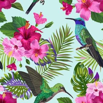 Tropikalny wzór z kolibry, egzotyczne kwiaty hibiskusa i liście palmowe. tle kwiatów z ptakami colibri do tkanin, tekstyliów, tapet. ilustracja wektorowa