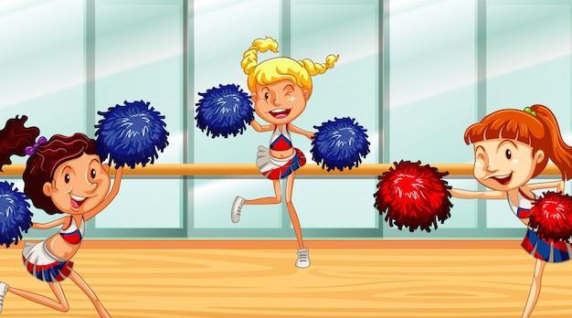 Trzech cheerleaderek tańczących w pokoju