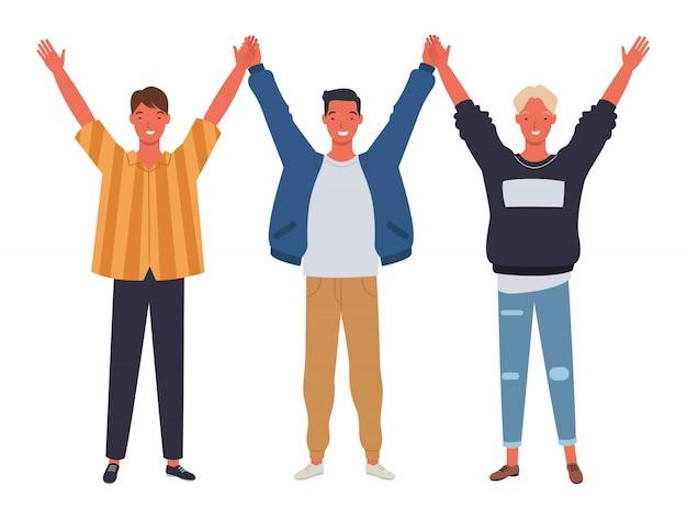 Trzech młodych mężczyzn trzyma i podnosi ręce.
