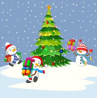 Trzy bałwanu mienia prezent i zimy tło