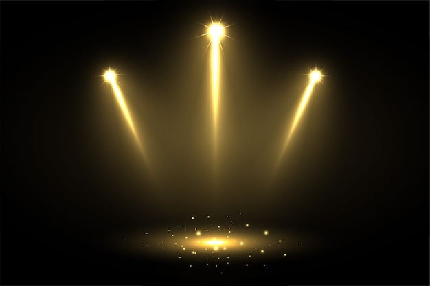 Trzy błyszczące światła punktowe skierowane w stronę środka