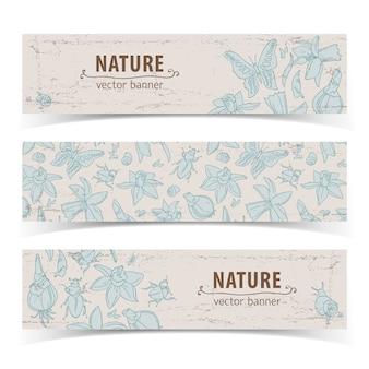Trzy jasne kolorowe na białym tle ręcznie rysowane doodle kwiaty baner z tytułami natura
