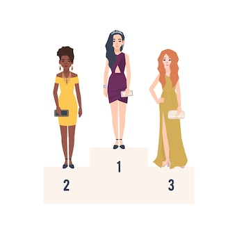 Trzy piękne kobiety ubrane w eleganckie suknie wieczorowe stojące na podium do nagrody.