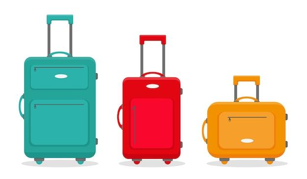 Trzy podróżne walizki na białym tle na białym tle