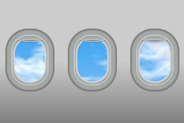 Trzy realistyczne iluminatory samolotu z białego plastiku z otwartymi roletami