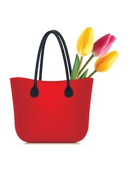 Tulipany w torbie na zakupy na białym tle. realistyczna ilustracja