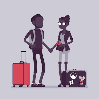 Turyści w strojach podróżnych z bagażem i walizkami