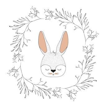 Twarz królika z zamkniętymi oczami w ozdobnej ramie gałęzi