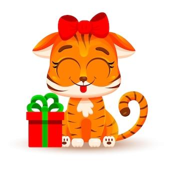 Tygrys kreskówka z kokardą i prezentem, pokazując język. ilustracja wektorowa na białym tle. boże narodzenie koncepcja, chiński nowy rok, symbol 2022. modne naklejki. kartka świąteczna.