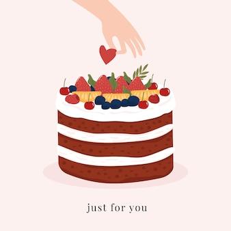 Tylko dla ciebie. piękny tort polewa owoce i ręka trzyma serce