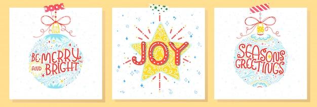 Typografia świąt i nowego roku. zestaw kart świątecznych z pozdrowieniami, bombkami, płatkami śniegu i gwiazdami.