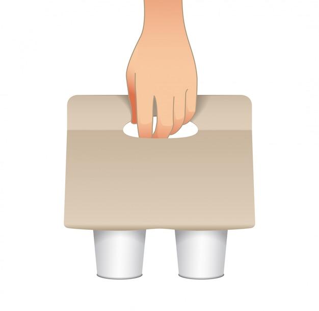 Uchwyt na karton na kawę z papierowymi kubkami i ludzką ręką. uchwyt na papier. tekturowy uchwyt na kubek do kawy na wynos